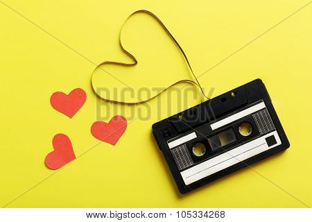 Audio Tape Cassette On Yellow Paper Background