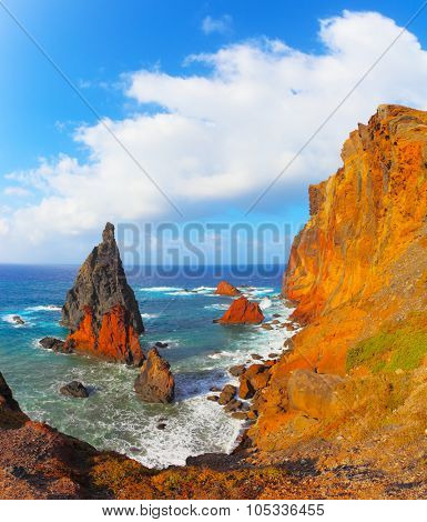 Arid eastern tip of the island of Madeira. Colorful pinnacles lit sunset. Atlantic storms
