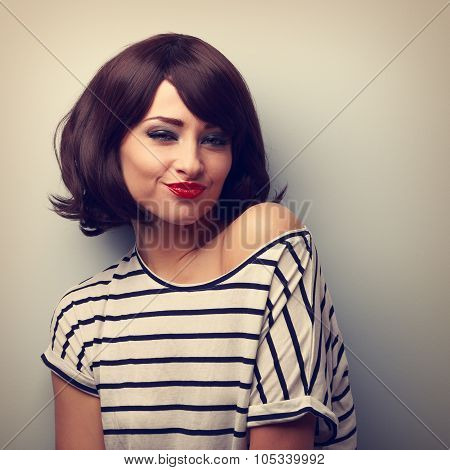 Fun Grimacing Young Woman With Short Black Hairstyle And Red Lips Joying. Vintage Portrait