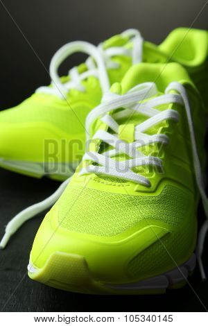 Pair Of Sport Shoes On Black Background