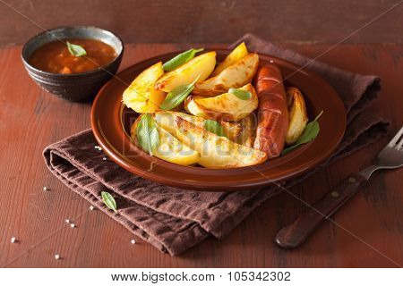 baked potato wedges and sausage over brown rustic table