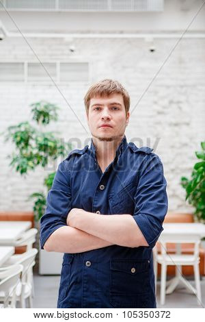 Portrait of confident man worker with arms crossed standing