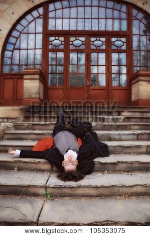 young man lying on stairs