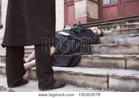 dead widow in black dress and veil