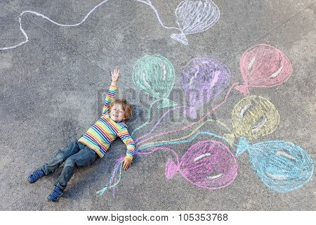 Kid Boy Having Fun With Colorful Balloons Drawing With Chalks