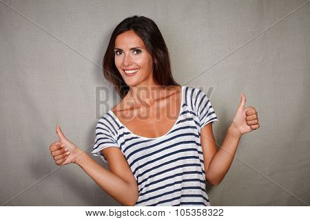 Young Woman Congratulating With Thumbs Up