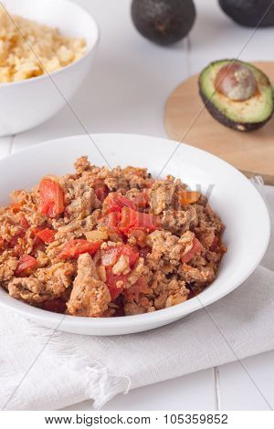 mexican taco or burrito stuffing: ground meat stir fried with diced tomatoes, spices and peppers in