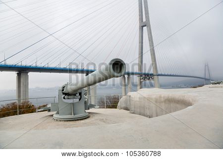 Guns coastal battery Vladivostok fortress on the island of Russian and Cable-stayed bridge. Vladivostok, Russia.
