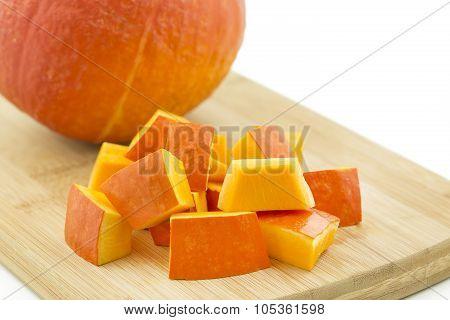 Pumpkin pieces arranged on a wooden board