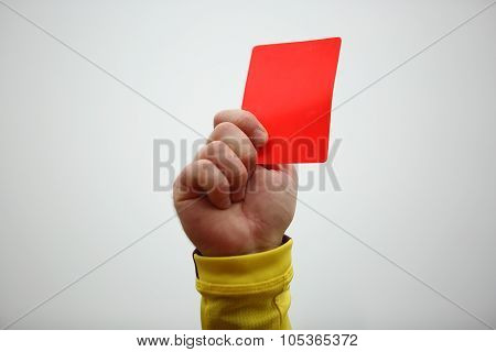 Hand Holding Up Red Card