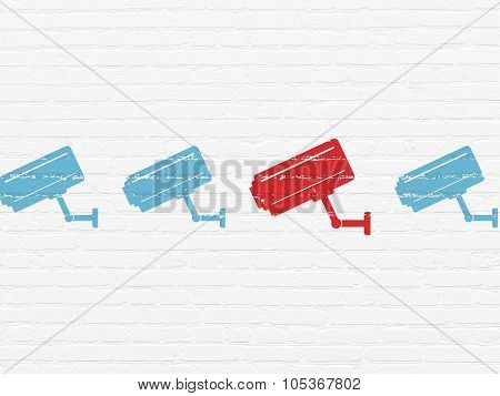 Safety concept: cctv camera icon on wall background