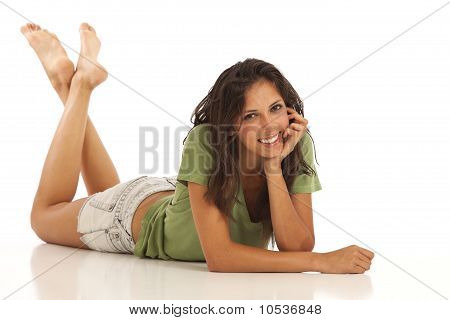 Portrait of cute young woman laying down
