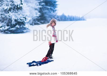Happy Child Playing In Snow