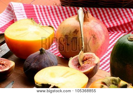 Chopped fig and persimmon on chopping board