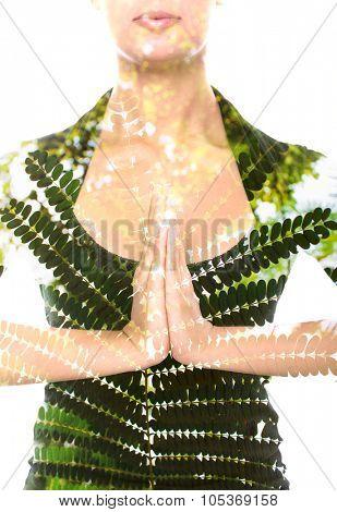 Attractive woman making namaste gesture