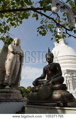 Buddha Statues With Stupa And Bo Tree