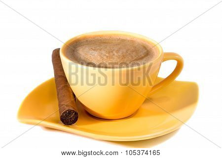 Yellow Cup Of Coffee And A Cigar On A Saucer On The Table