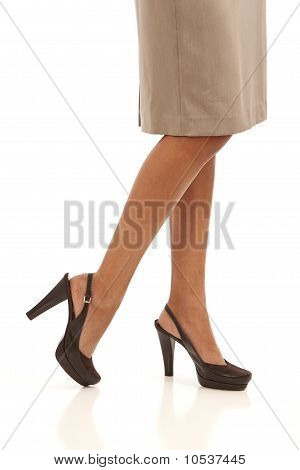 Legs and feet of young businesswoman