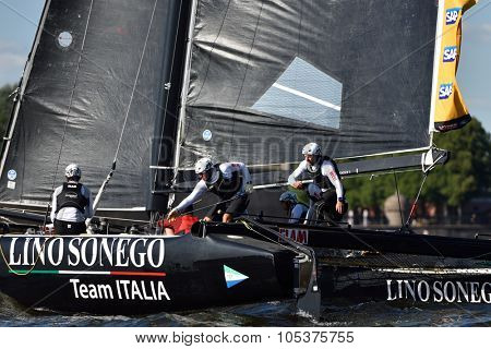 ST. PETERSBURG, RUSSIA - AUGUST 20, 2015: Catamaran of Lino Sonego Team Italia of Italy during the 1st day of St. Petersburg stage of Extreme Sailing Series. Red Bull Sailing Team, Austria won the day