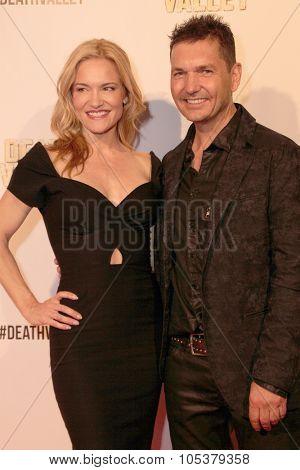 LOS ANGELES- OCT 17: Victoria Pratt and TJ Scott arrive at the