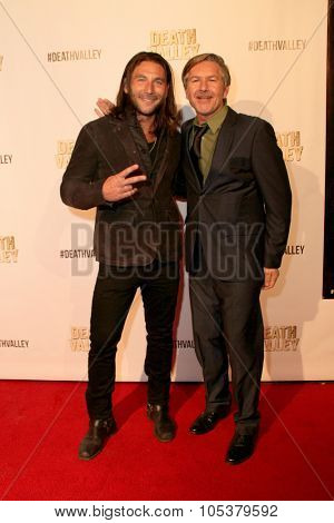 LOS ANGELES- OCT 17: Zach McGowan and Sean Cameron Michael arrive at the