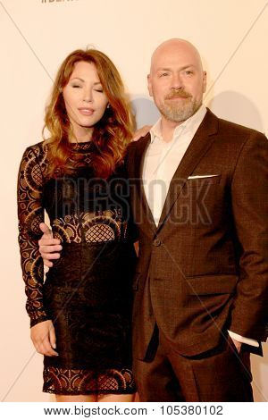 LOS ANGELES- OCT 17: Jaime Slater and Steven DeKnight arrive at the