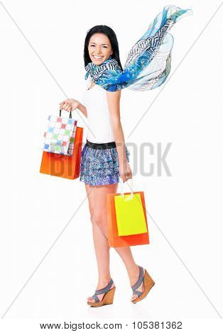 Happy woman holding many shopping bags, isolated over white background