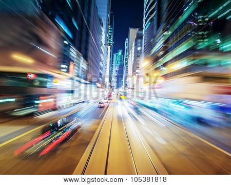Abstract urban background of night city blurred by motion