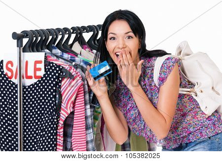 Shopping woman holding credit card or gift card, isolated on white background