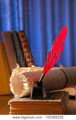 Red quill pen and papyrus sheet