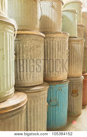 Old metal trash cans in color