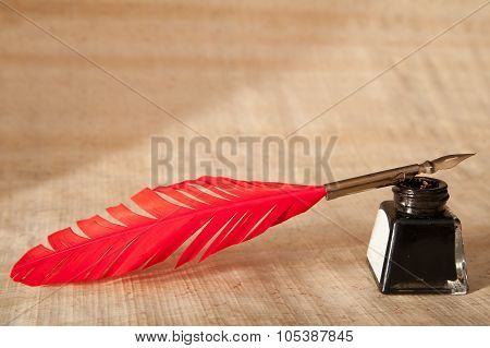 Quill pen and black inkwell
