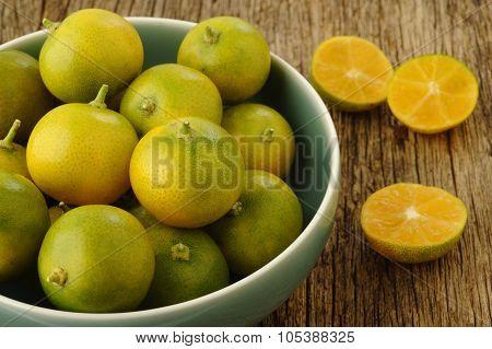 Kumquat Citrus Fruits In Bowl