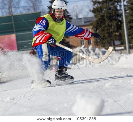 RUSSIA, OBUKHOVO - JANUARY 10, 2015: 2-nd stage children's hockey League bandy, Russia. Players warm