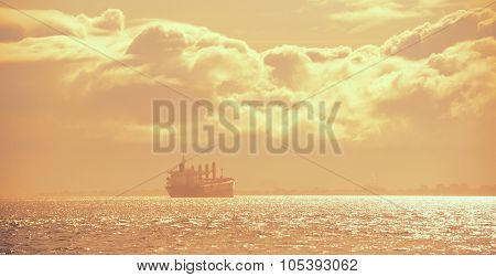 Cargo ship in San Francisco over Pacific Ocean at sunset
