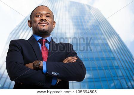 Smiling black businessman outdoor