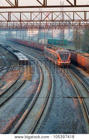 Modern Electric Train Moving Through Railway Station