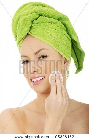 Beautiful caucasian woman with cotton pad.