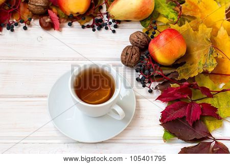 Cup Of Tea, Apples, Pears, Nuts And Autumn Leaves. Autumn Still Life