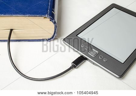 eBook connected to the old thick blue book with a cable