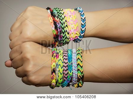 Female Hands With Rubber Bracelets
