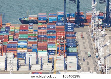 Container ship unloading at a dock