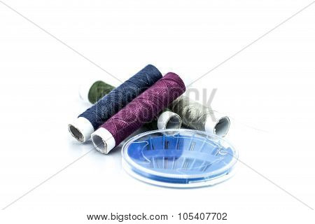 Yarn And Sewing Needles Isolated On White Background