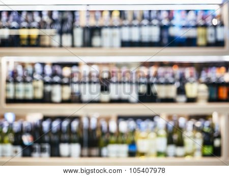 Blurred Wine Liquor Bottles On Shelf Wholesale Shop