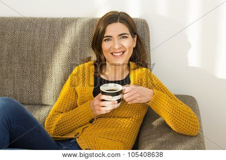 Beautiful woman at home Having a good time with cup a coffee