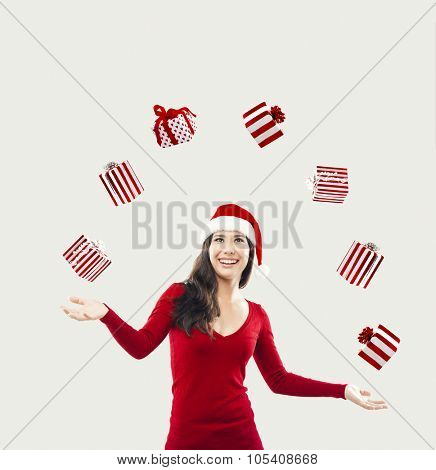 A beautiful woman juggling gifts on the air in a white background