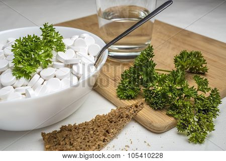 plate filled with medical pills drugs is on the table with a spoon inside, next to the food