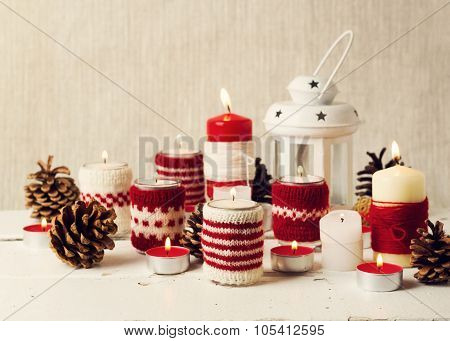 Christmas Handmade. Christmas Candles In The Candle Holders Knitted.
