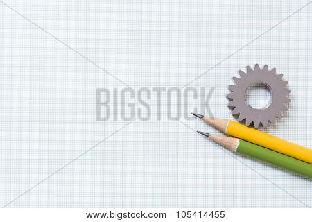 Gear And Pencils On Graph Paper,concept And Idea