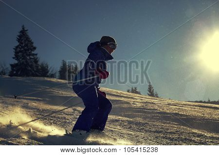Girl Skier Slade Down On The Snow Hill In Bright Sun Backlight